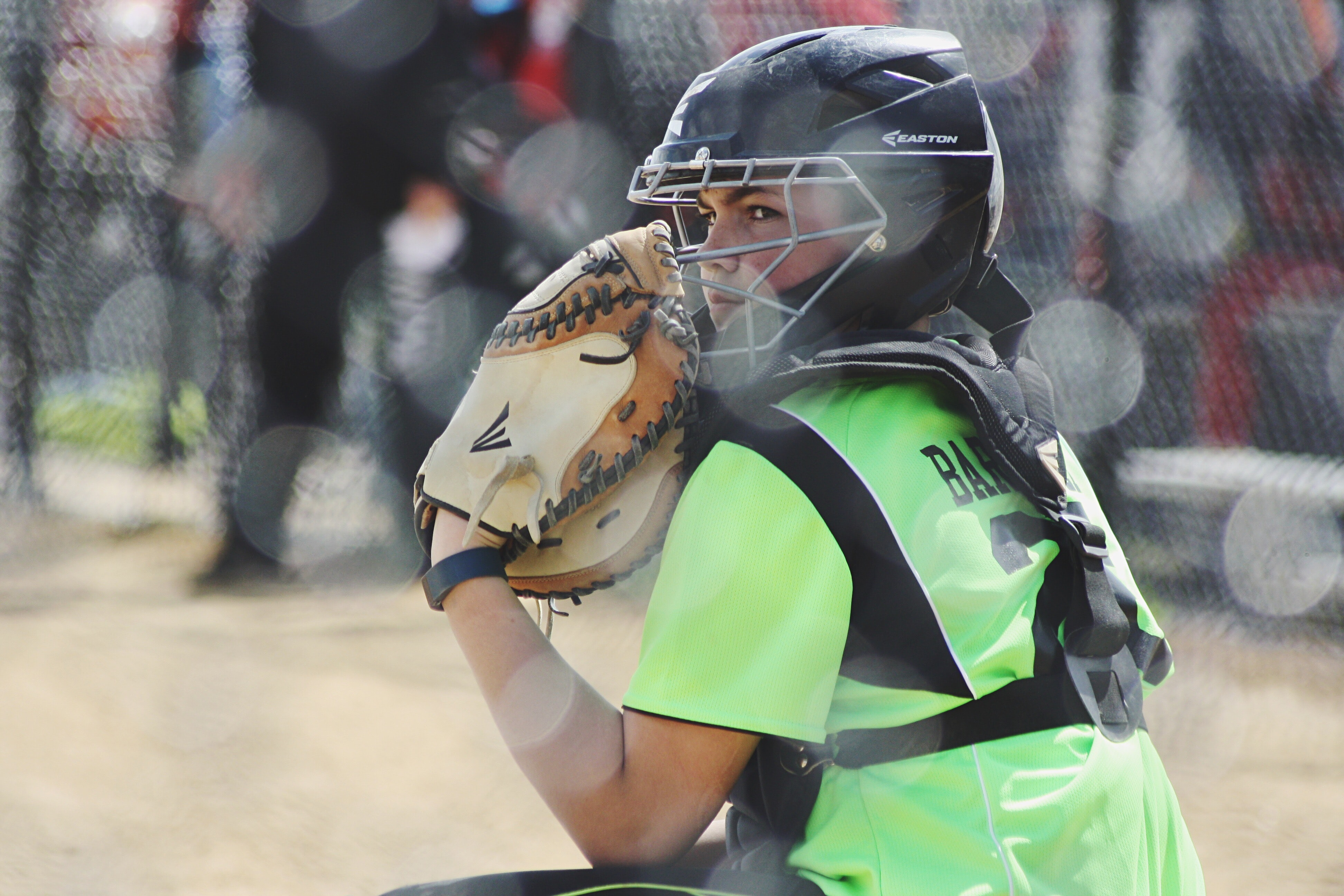 Softball catcher looking for signs