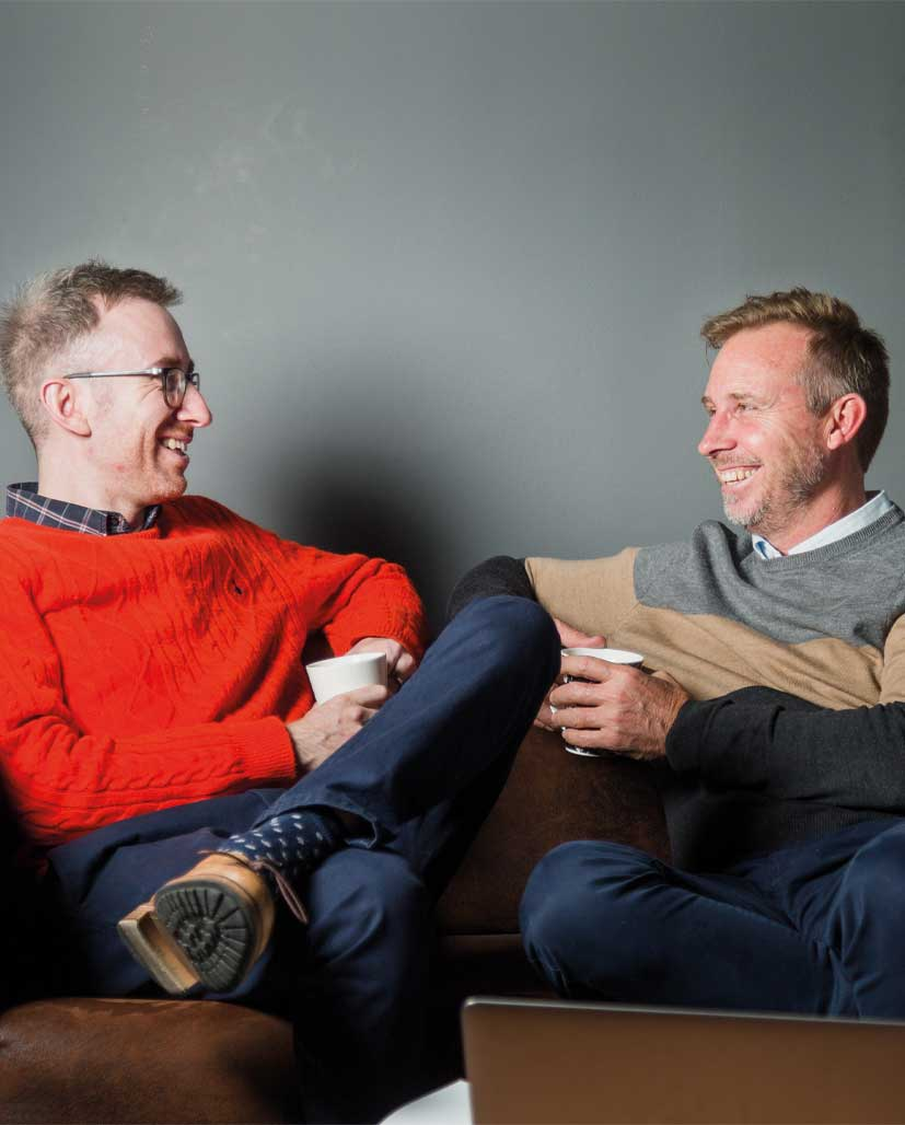 Founders of The Pulse Rooms having a conversation on the sofa