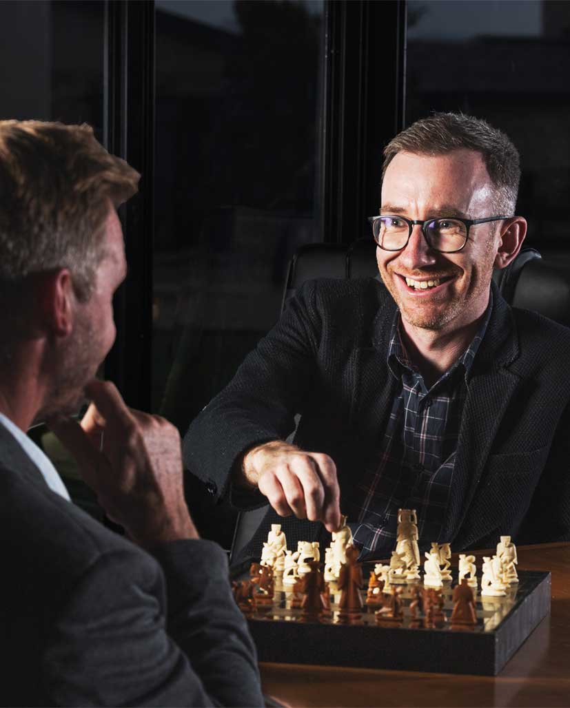Founders of The Pulse Rooms playing a game of chess