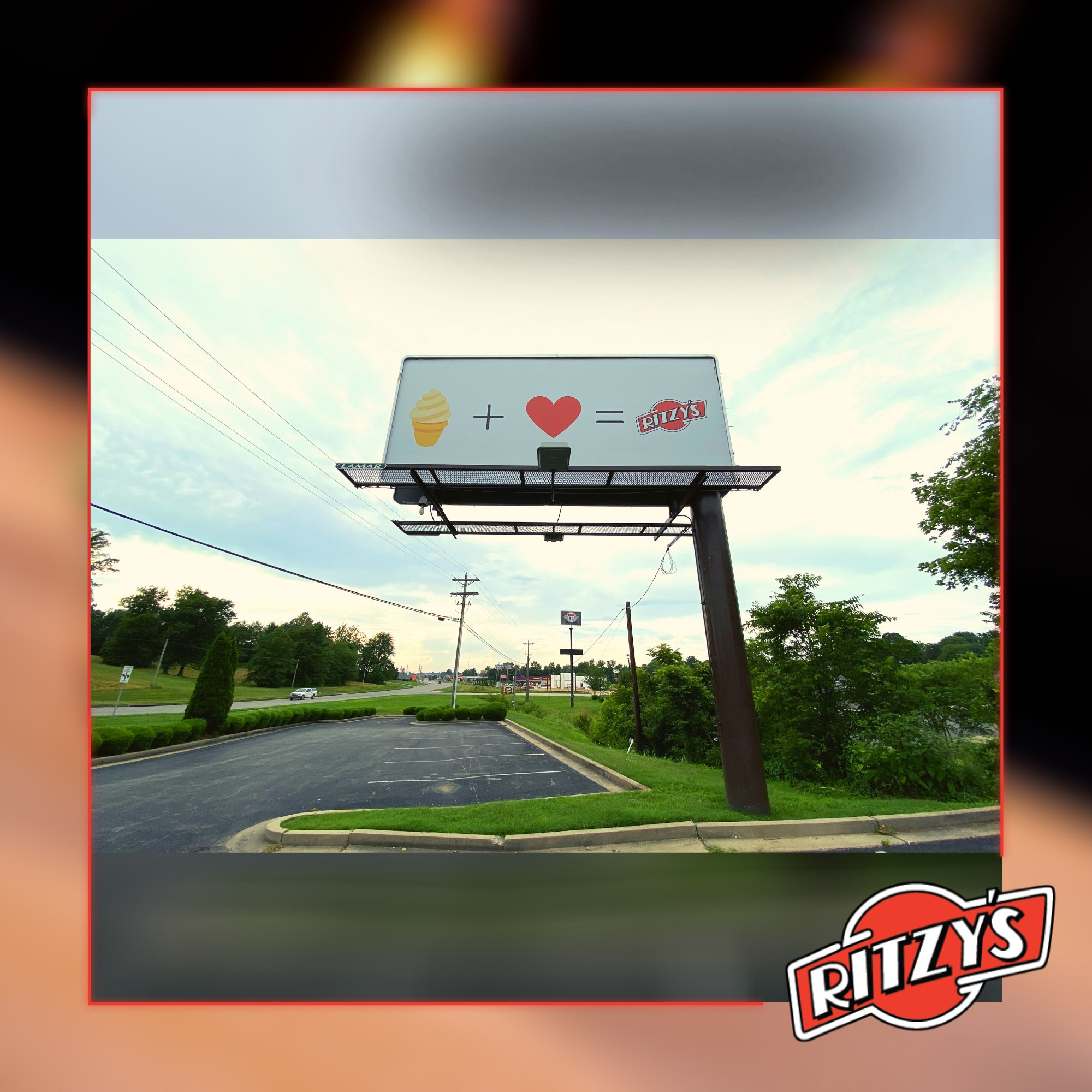Ritzy's billboard that depicts the emojis: ice cream + heart = Ritzy's