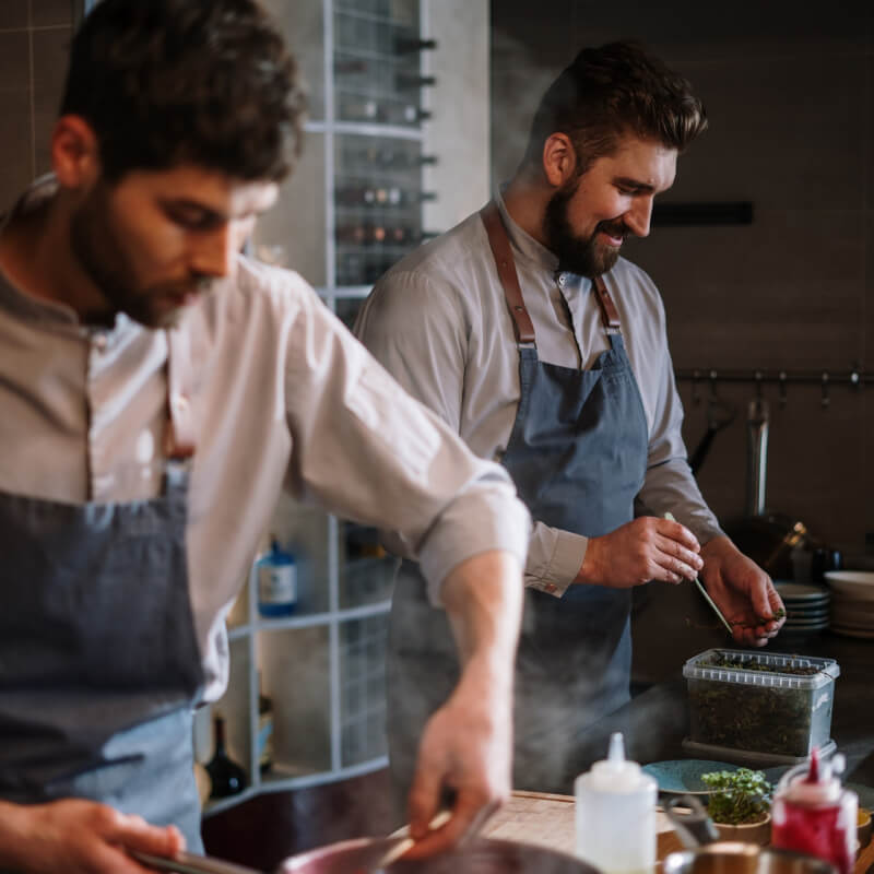 Two men cooking in a kitchen