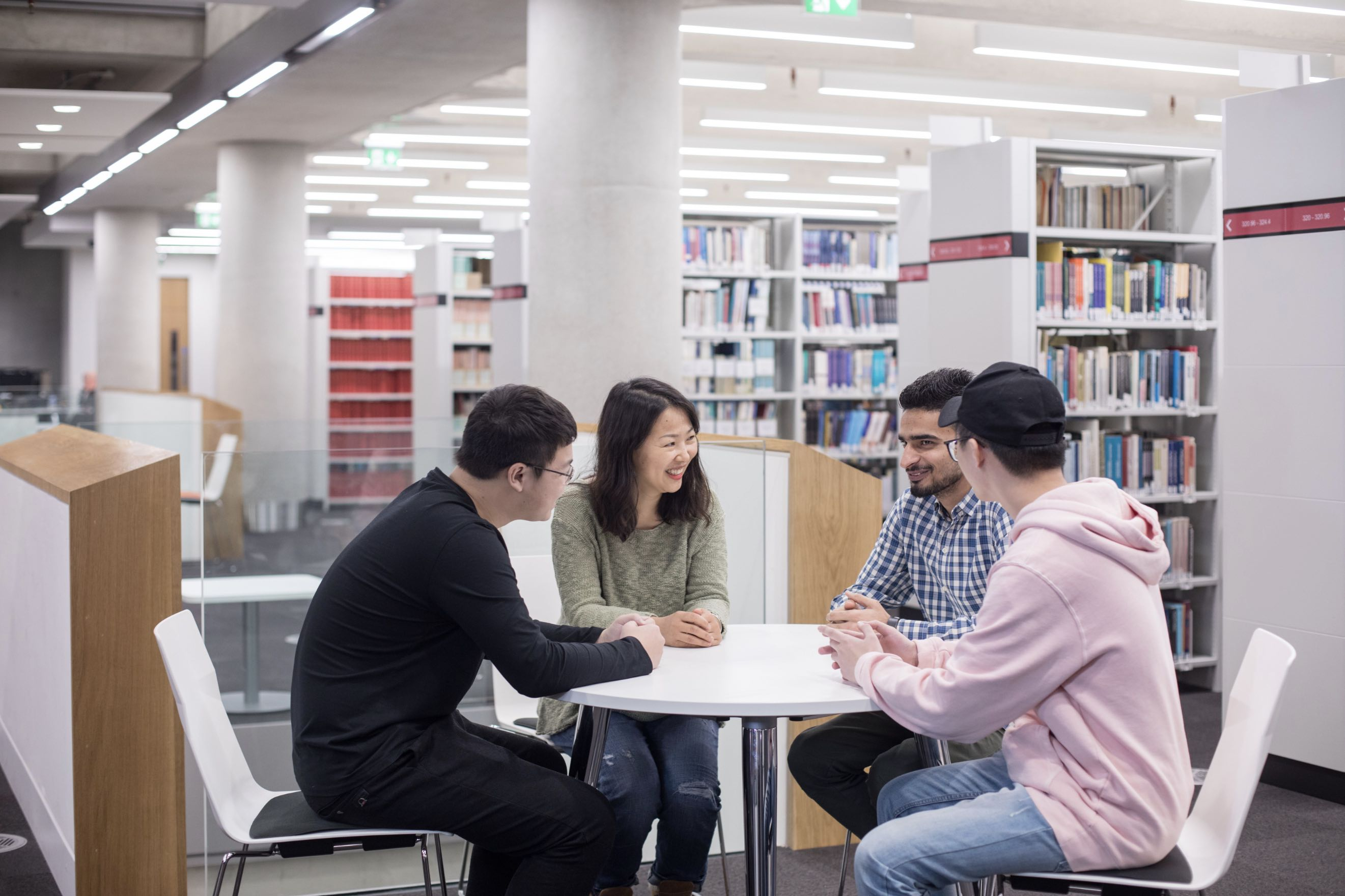 Students chatting in University of Bedfordshire library