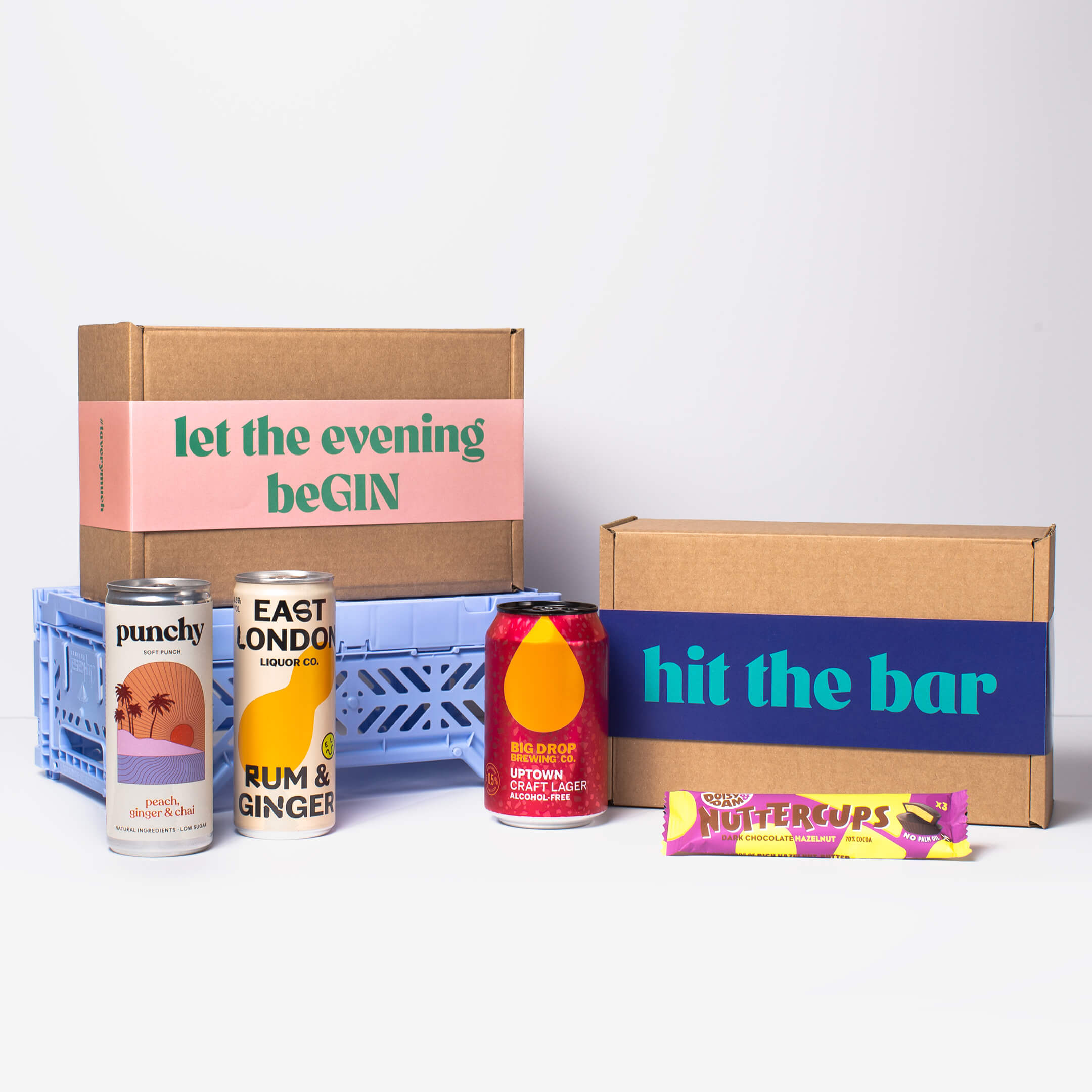 """Lead home page hero shot, showing a selection of products from Punch, East London Liquor Company, Big Drop Brewery & Doisy & Dam as well as two of our beautiful boxes - """"Let the evening beGIN"""" and """"hit the bar""""."""