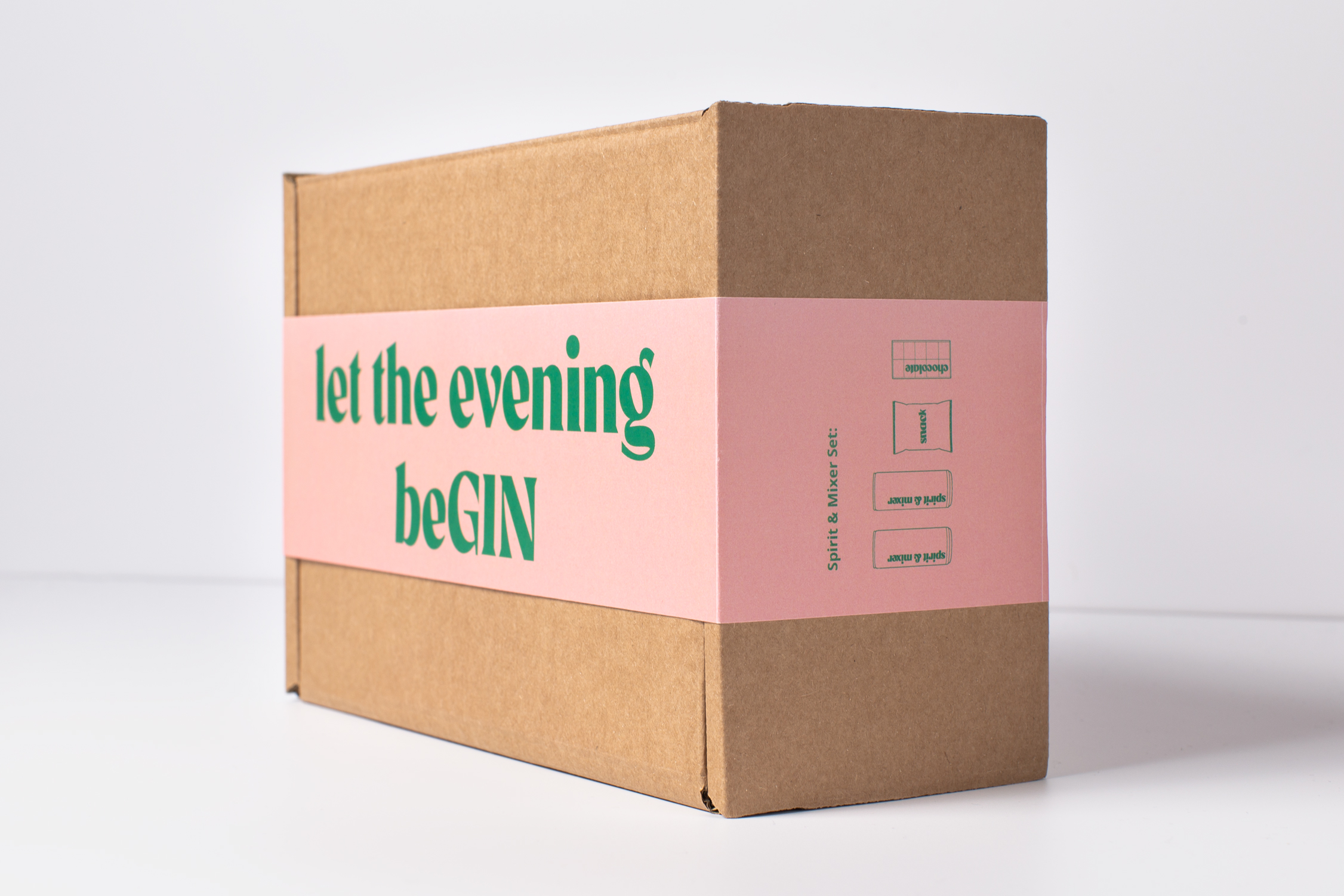 """ta. """"let the evening beGIN"""" box from the side, showing the contents of the box and the front lettering"""