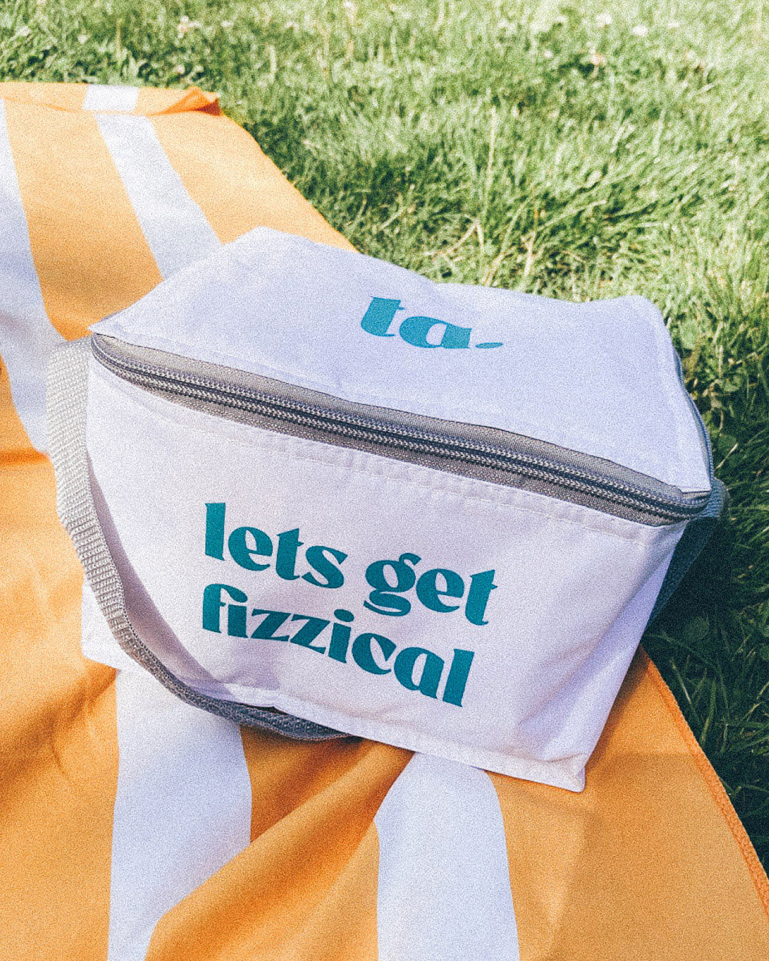 ta. cool bag on a towel on the grass. Links through to our Park Sets Listing Page for shopping