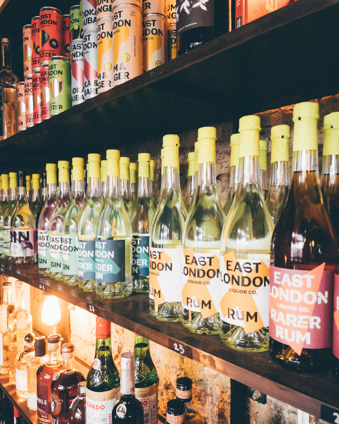 Shelving showing East London Liquor product, link clicks through to our mission to support small British Brands.