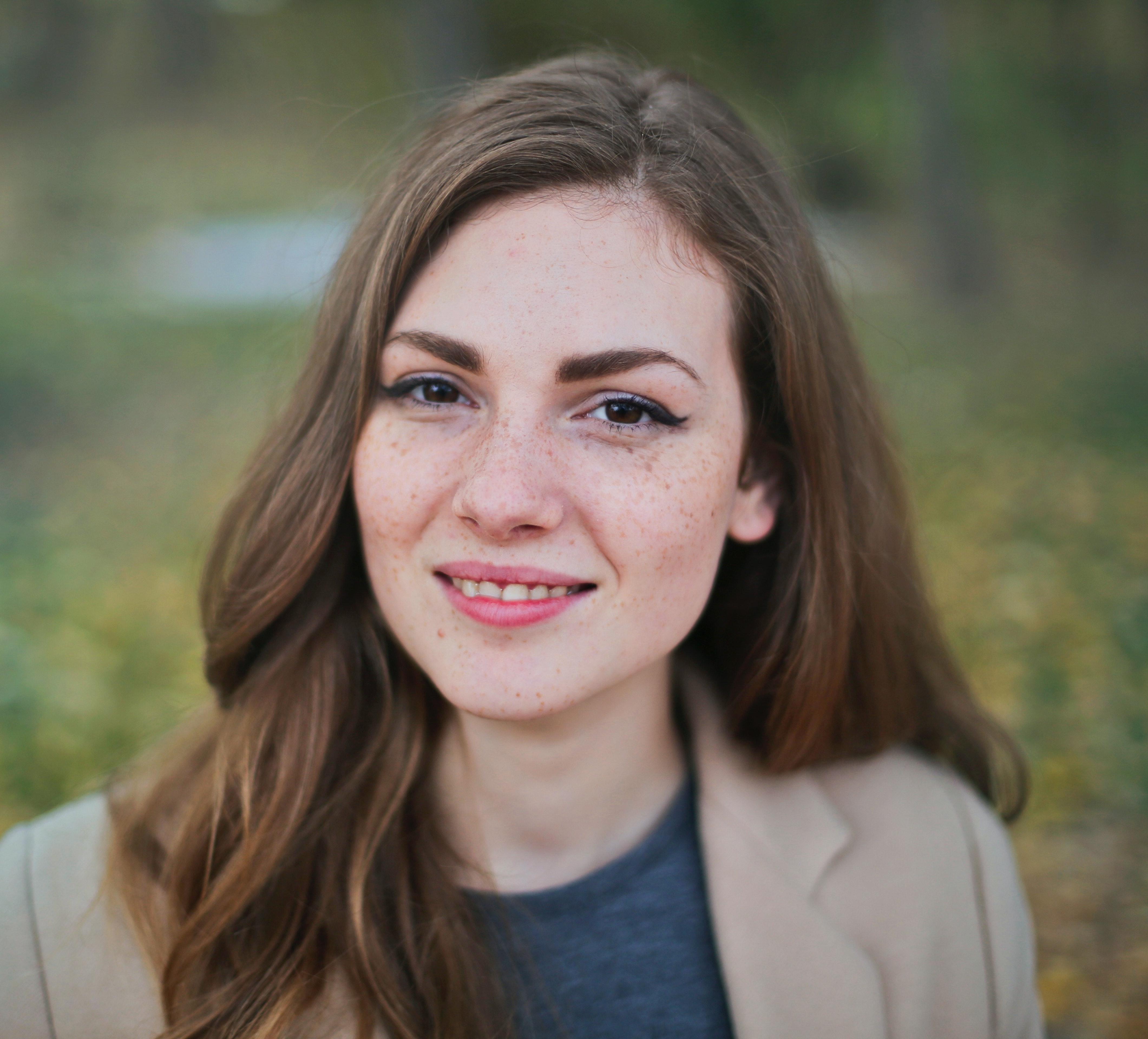A headshot of a woman