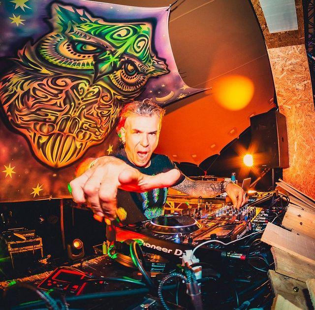 psy-trance dj with decks