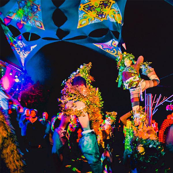 festival performers on stilts