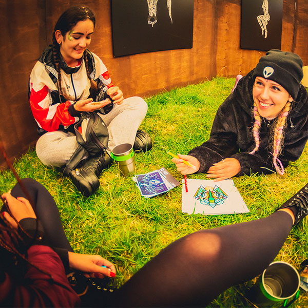 people drawing at festival