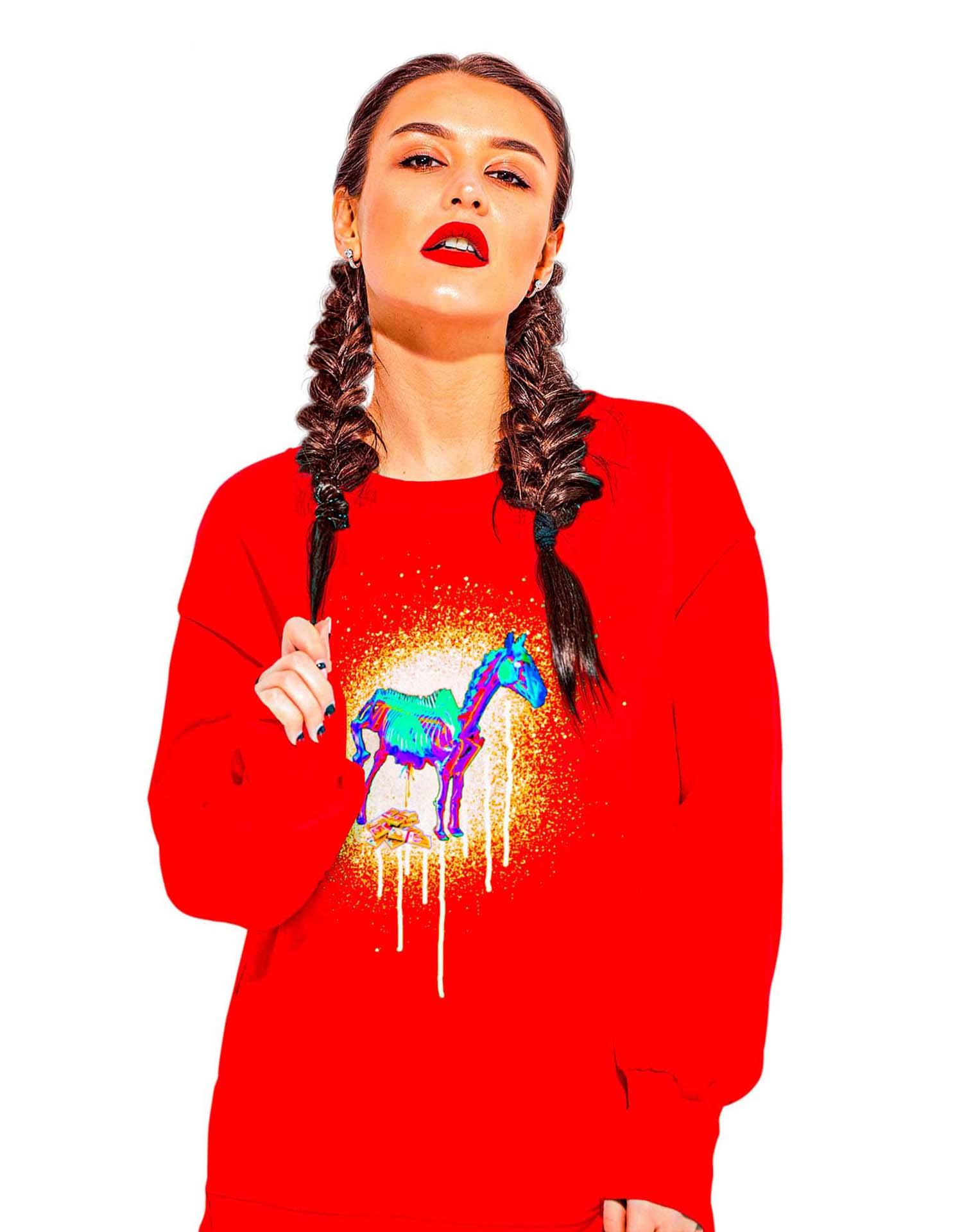 Woman in red sweatshirt wearing Satin.