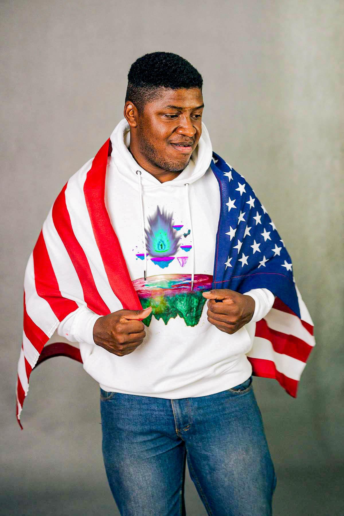 Man holding American flag wearing hoodie by 91 APPAREL