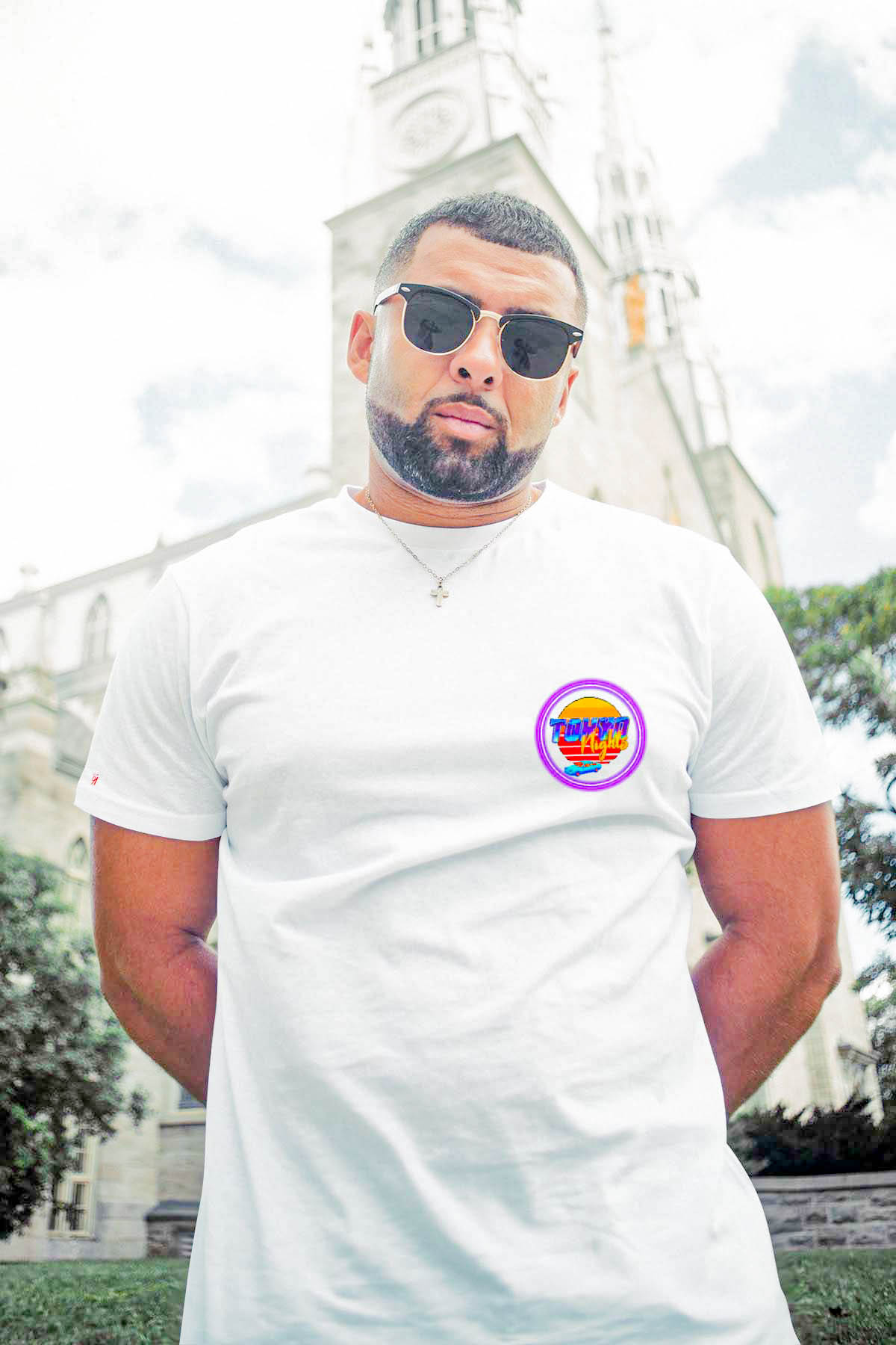 Man standing in front of building wearing shirt by 91 APPAREL