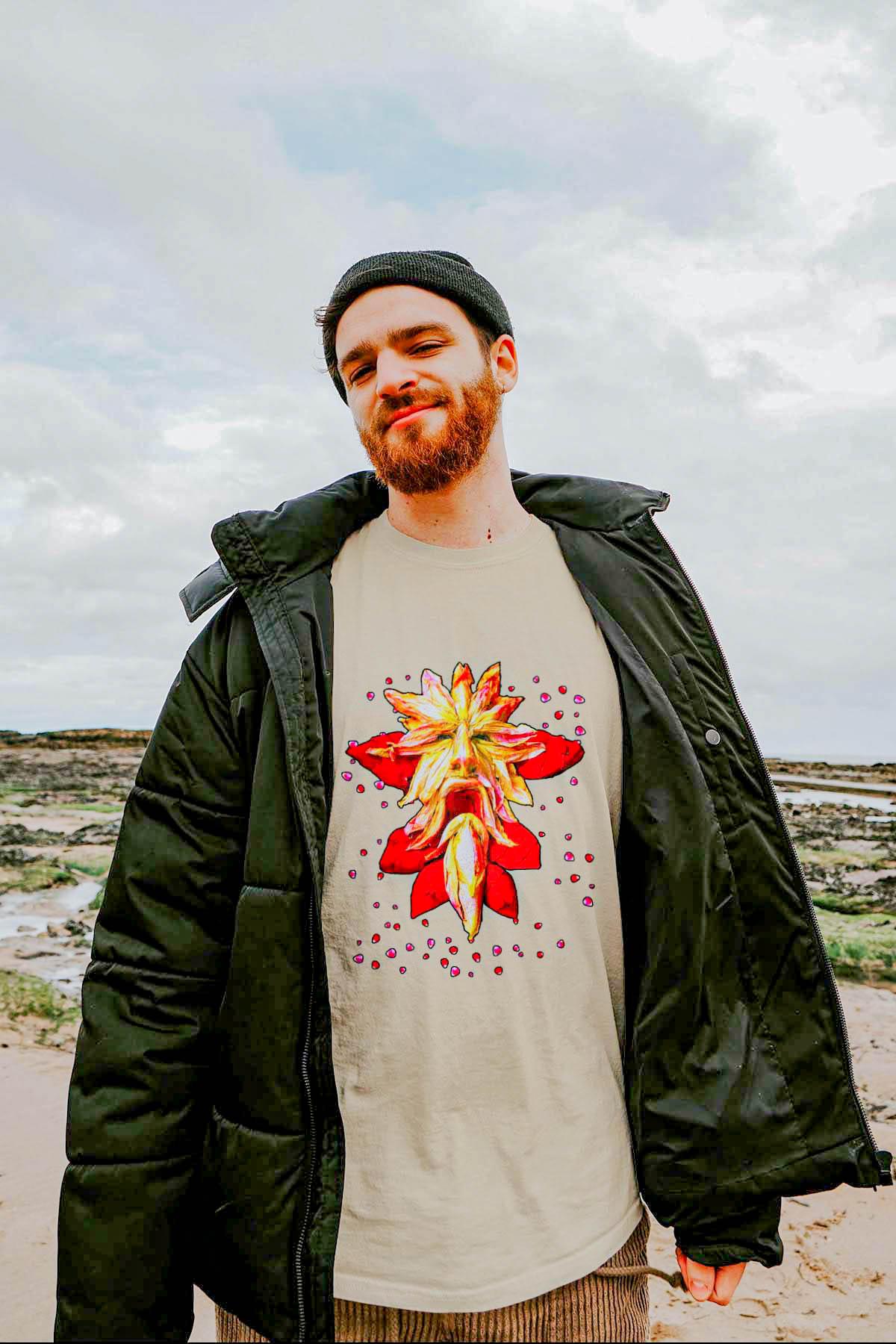 Man standing on beach wearing shirt by 91 APPAREL