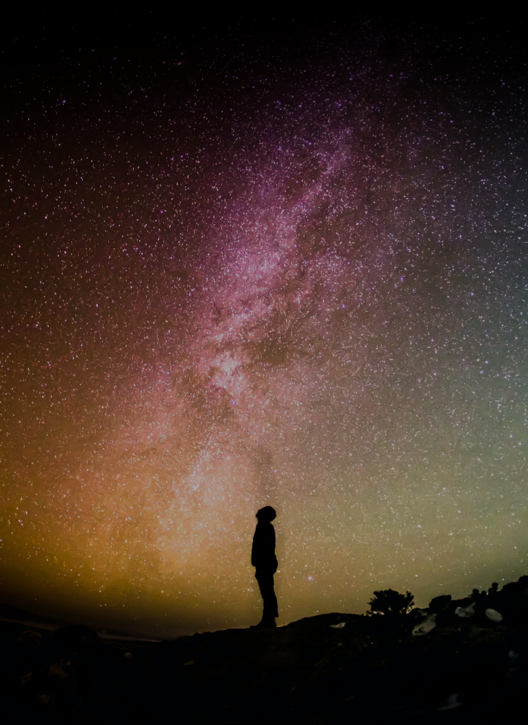 Person staring at the night sky with stars