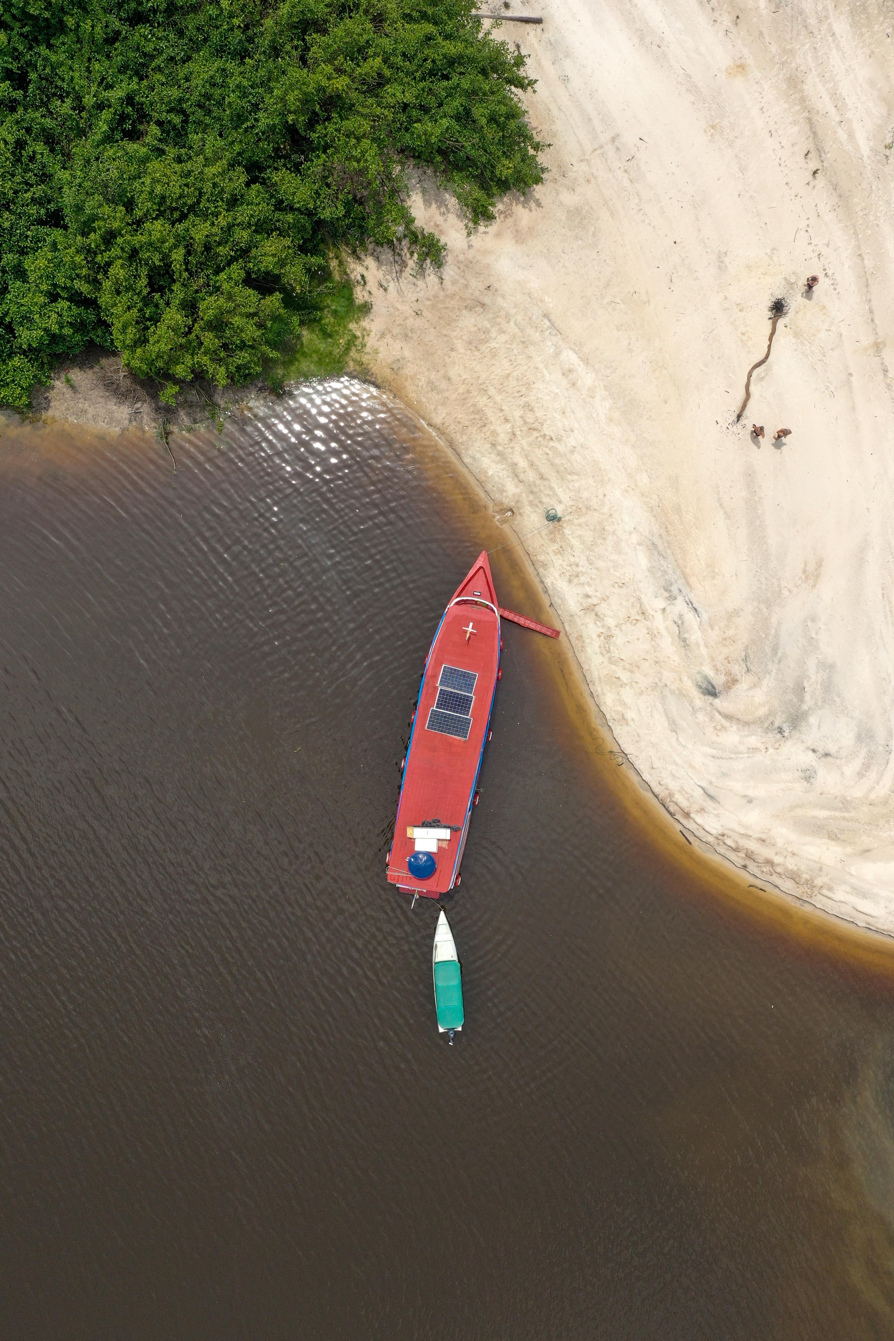 Boat on Rio Negro in Amazon rainforest Brazil