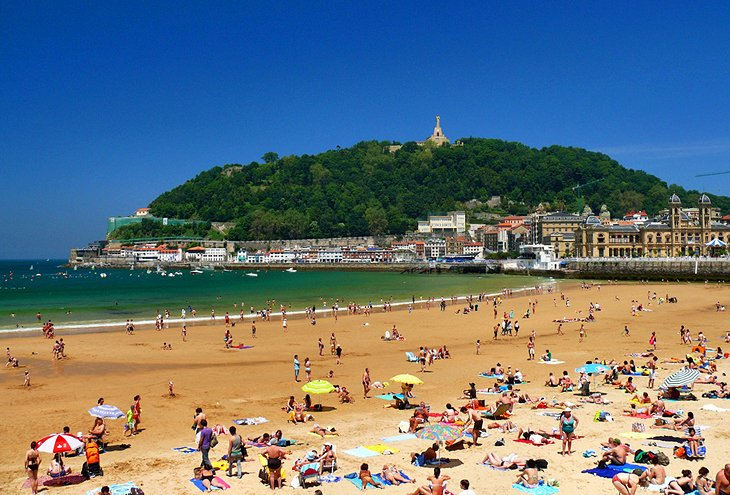 La Concha Beach in the foreground with the city of San Sebastian, Spain in the background.