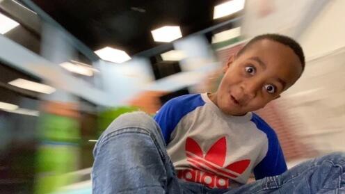 Boy spinning on Whirly-Go-Round POV 2