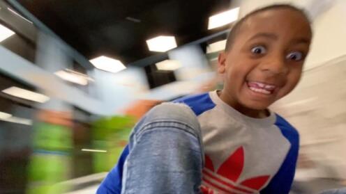 Boy spinning on Whirly-Go-Round POV 3