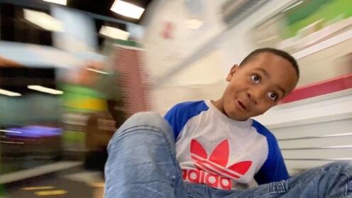 Boy spinning on Whirly-Go-Round POV 1