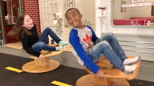 Children spinning on Whirly-Go-Round 3
