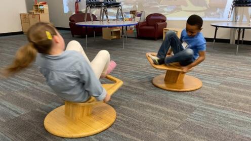Children spinning on Whirly-Go-Round 2
