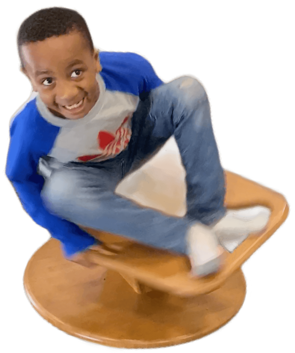 Boy spinning on a Whirly-Go-Round