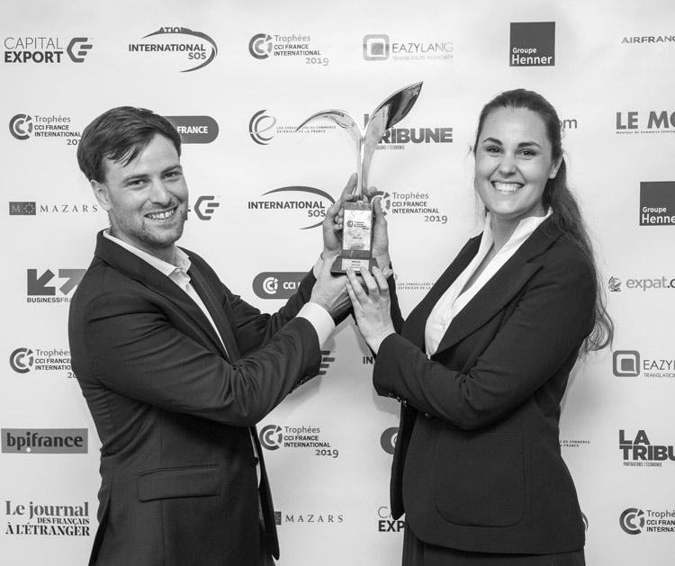 Pauline and Sebastien holding trophy