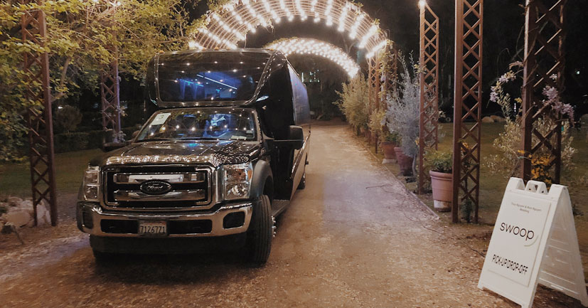 Swoop Bus under lights at wedding venue