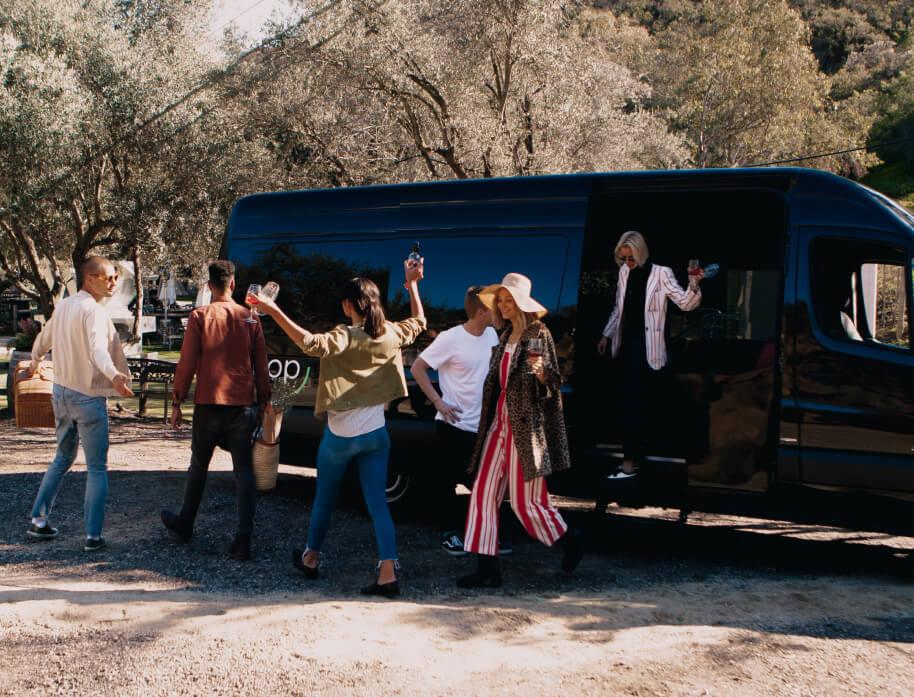 Group of people exiting Swoop Van