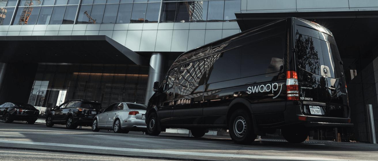 Swoop van outside of office building