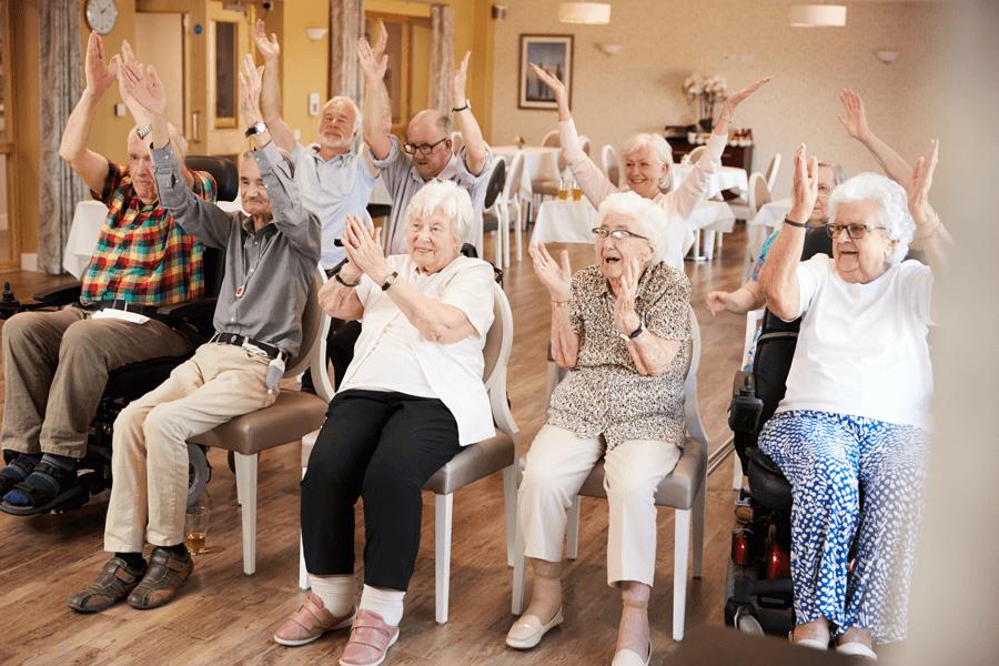 Happy active elderly patients in care home