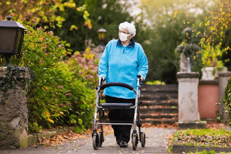 Elderly Patient Walking in Face Mask