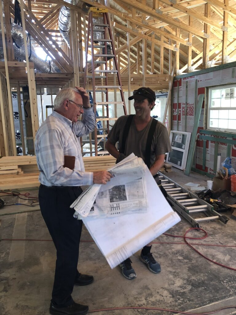 homeowner with contractor