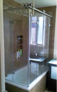 Quad Fold Shower Door and Bi-fold Shower door over a tub.  Corner folding double door shower enclosure.