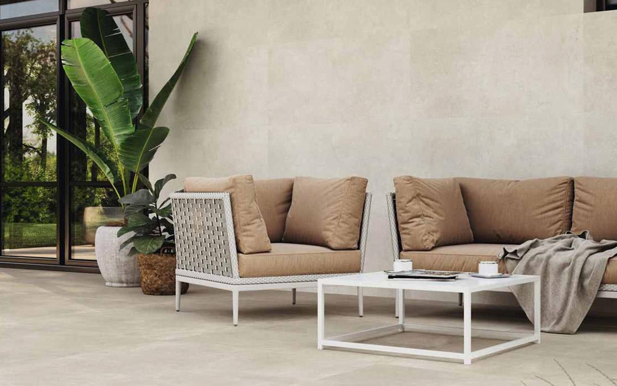 Large cement look porcelain tiles, outdoor furniture.