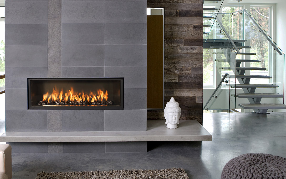 Honed granite slabs, gas burner fireplace, Stucco floor, floating stairs, frameless glass, wood panel accent wall.