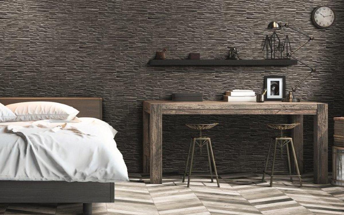 Rustic bedroom, Stone cladded wall, chevron pattern wood look floor tile.