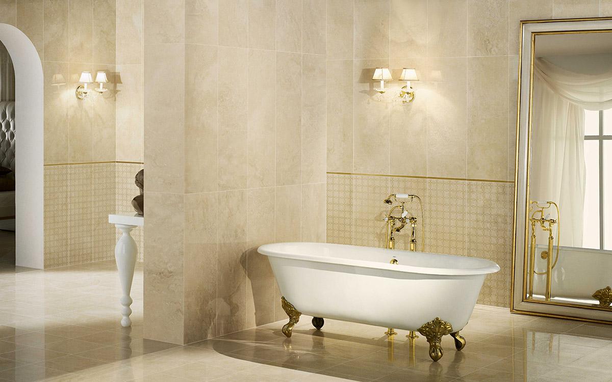 Travertine wall & floor, freestanding bath, gold accents.