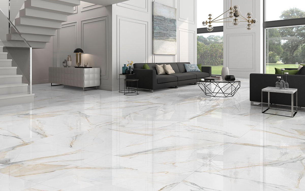Large format Calacatta marble slabs, modern artwork and furniture.