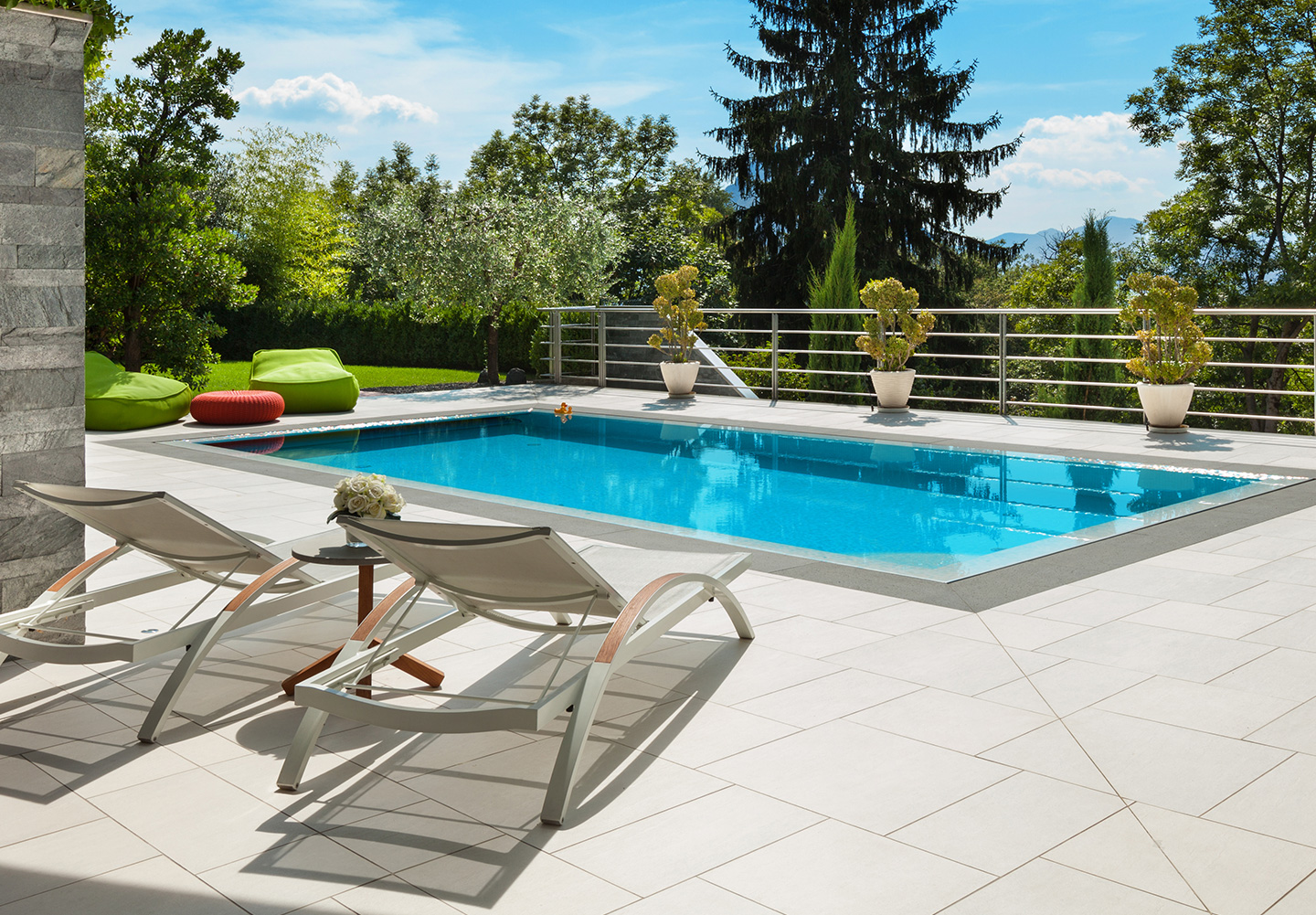 French pattern slip resistant tile, pool coping, silver grey quartzite cladding, pool sun lounger.