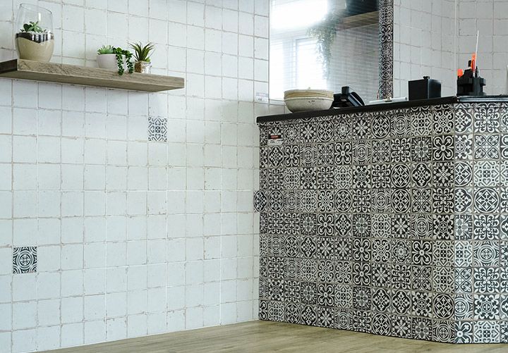 Vintage Moroccan tiles, floating solid wood shelves, Mirror, black granite counter top.