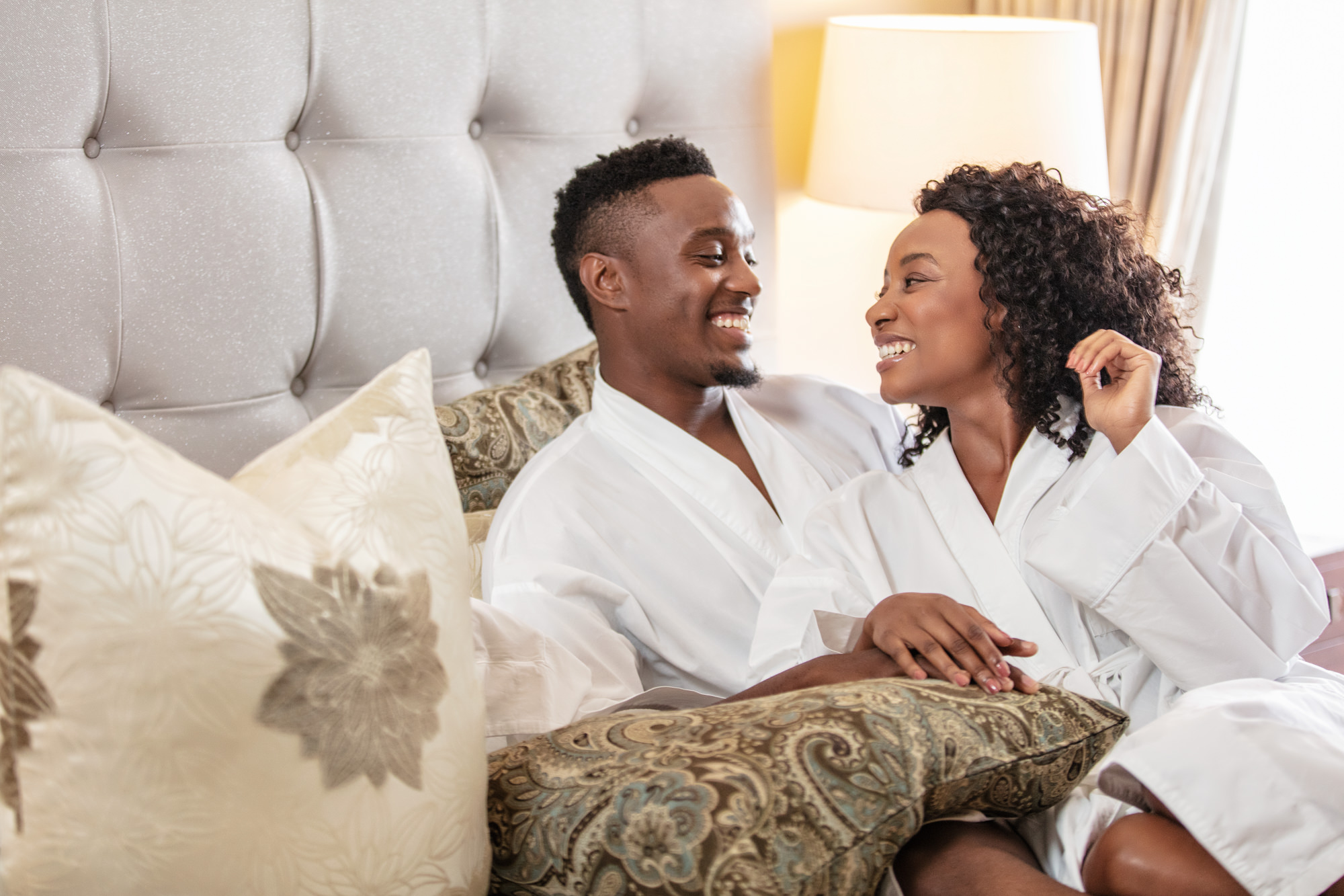 Image of man and Woman in a hotel suite at the Beverly Hills Hotel in uMhlanga Rocks, Durban for  Tsogo Sun's Image Library & Content Library by Michelle Wastie Photography