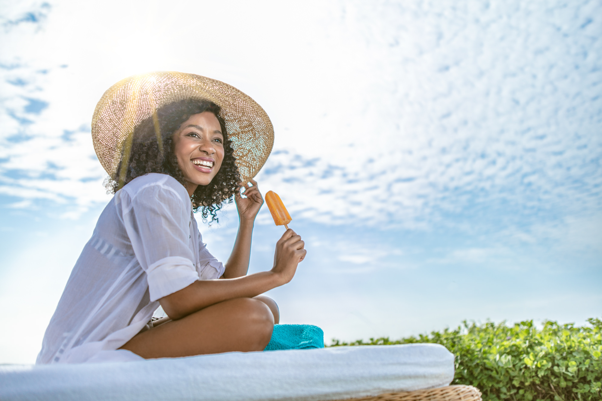 Image of Woman eating an ice cream at the Beverly Hills Hotel in uMhlanga Rocks, Durban for  Tsogo Sun's Image Library & Content Library by Michelle Wastie Photography