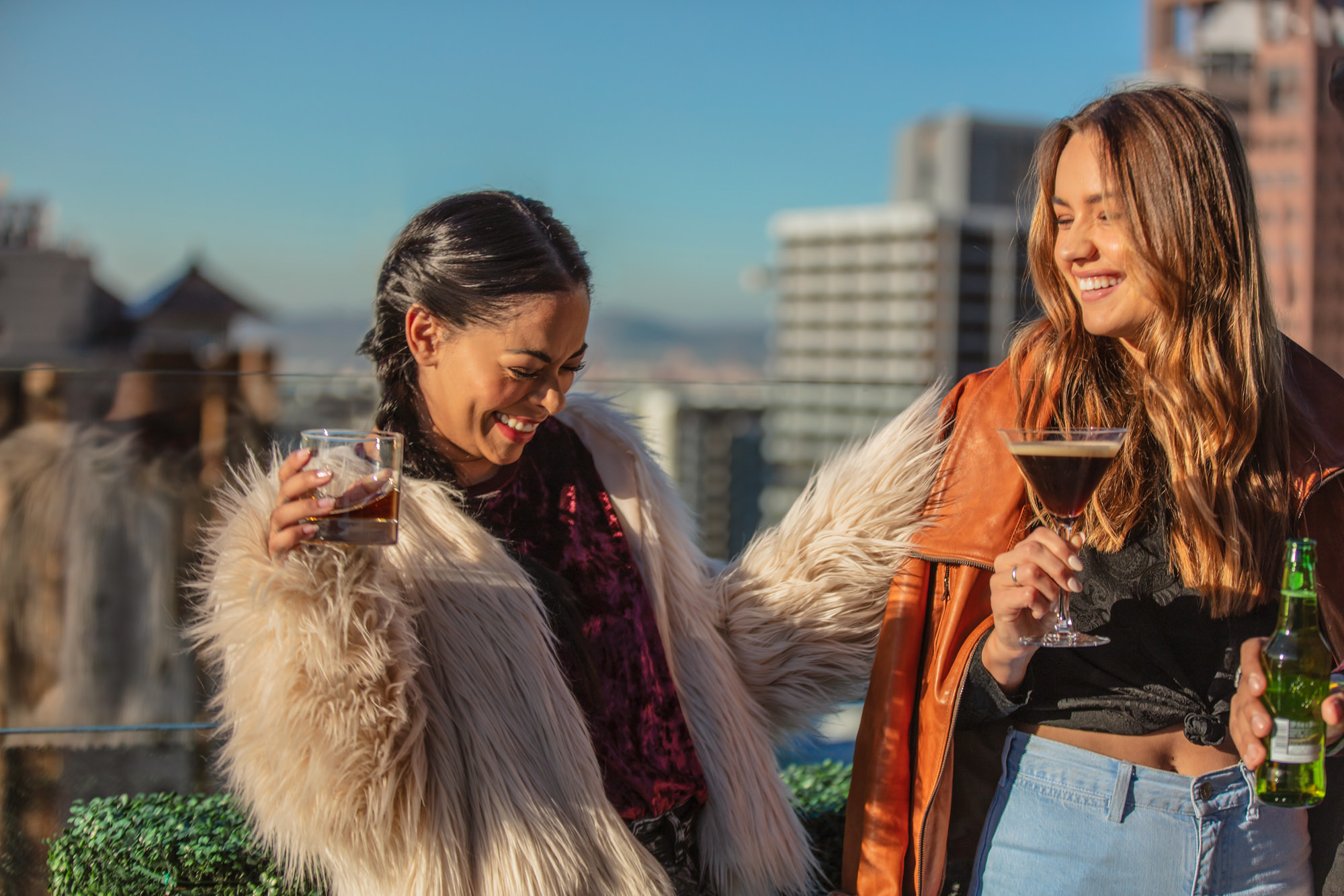 Image of girl friends having sundowners at the SunSquare Cape Town City Bowl Hotel Rooftop Bar for Tsogo Sun's Image Library & Content Library by Michelle Wastie Photography