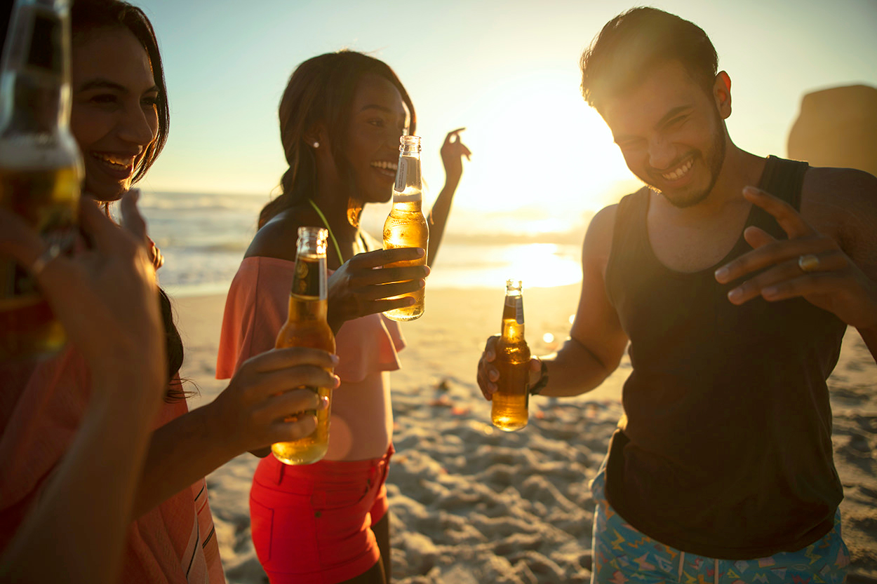 Image of friends having fun on the beach in Cape Town for Tsogo Sun's Image Library & Content Library by Michelle Wastie Photography