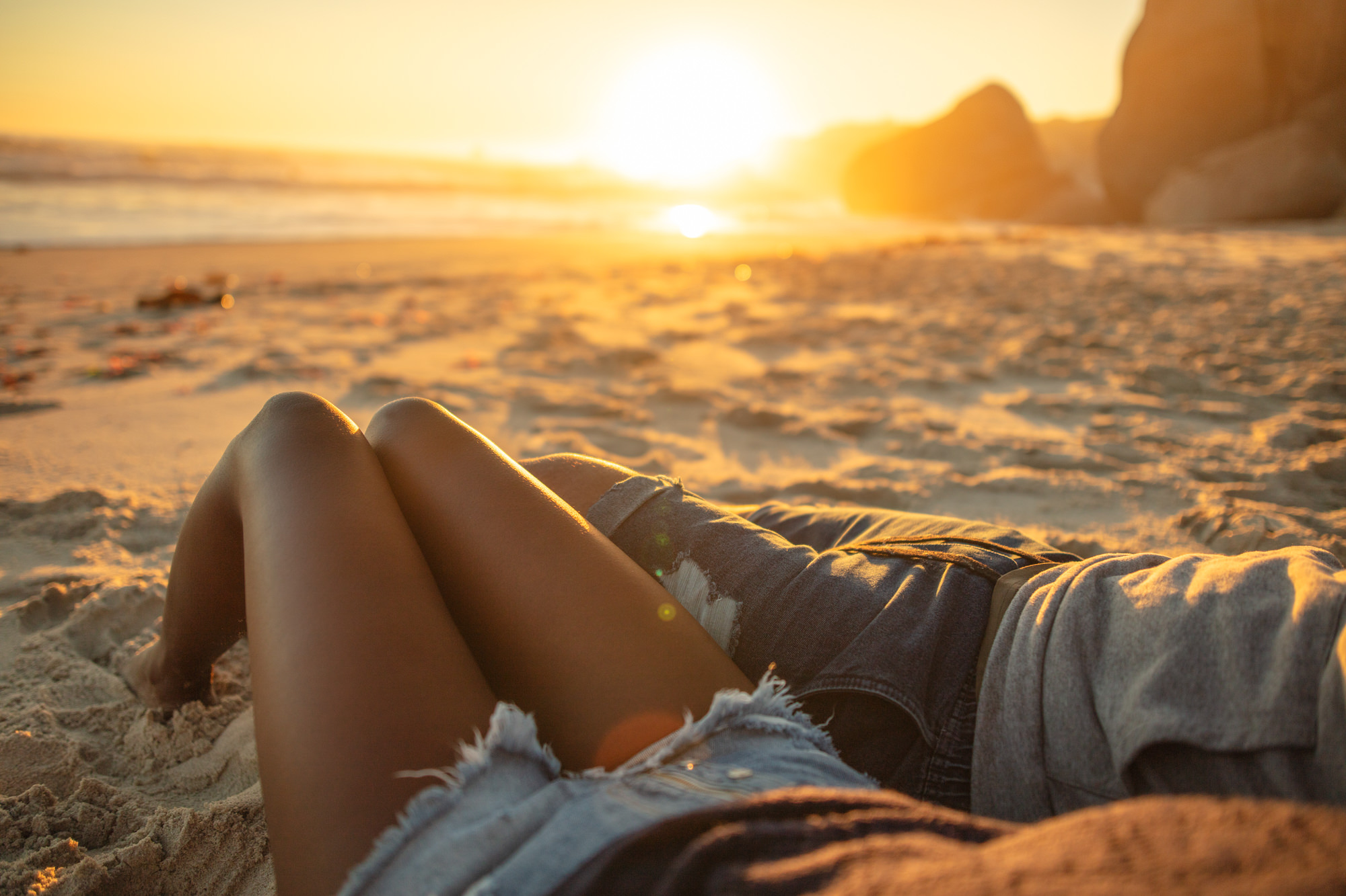Image of couple watching the sunset on the beach in Cape Town for Tsogo Sun's Image Library & Content Library by Michelle Wastie Photography