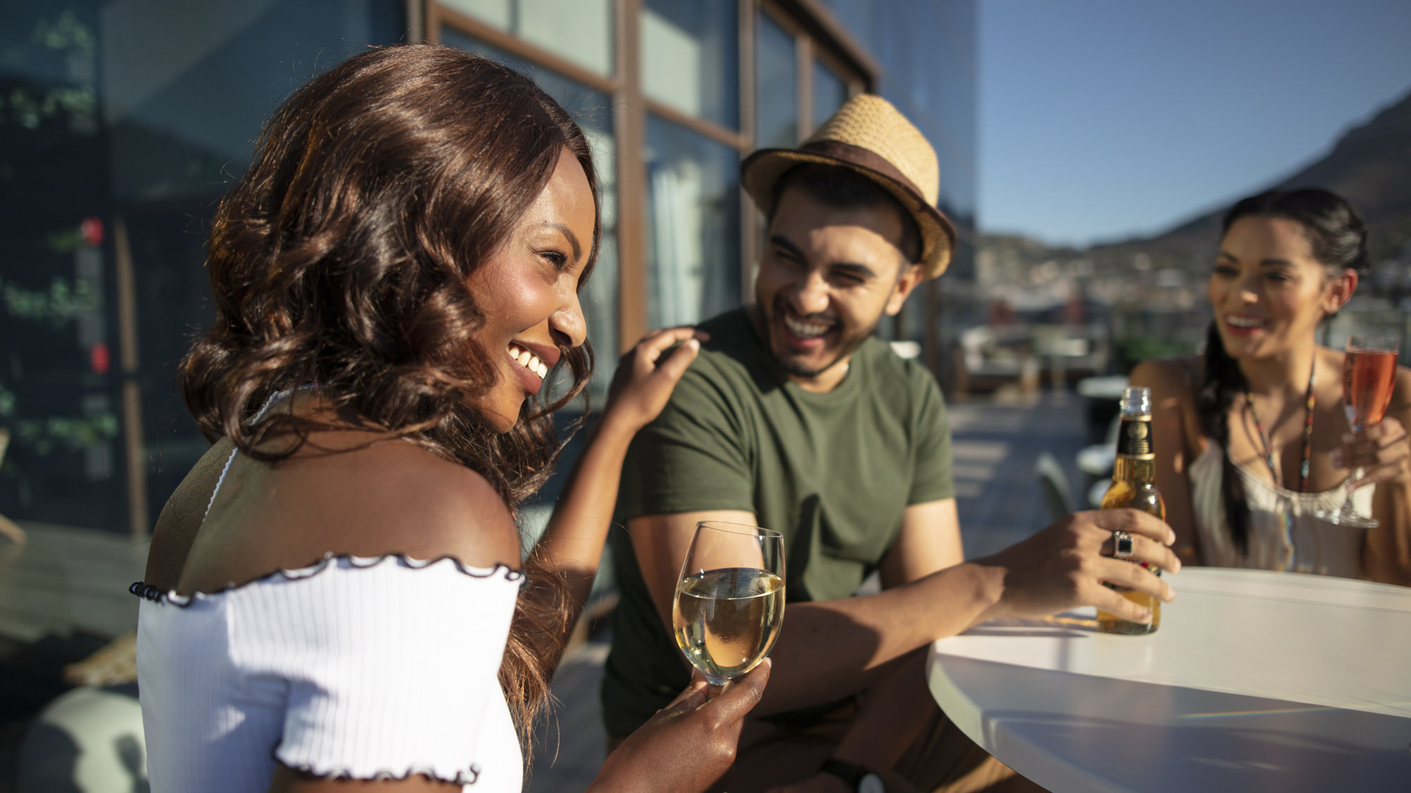 Image of friends having sundowners at the SunSquare Cape Town City Bowl Hotel Rooftop Bar for Tsogo Sun's Image Library & Content Library by Michelle Wastie Photography