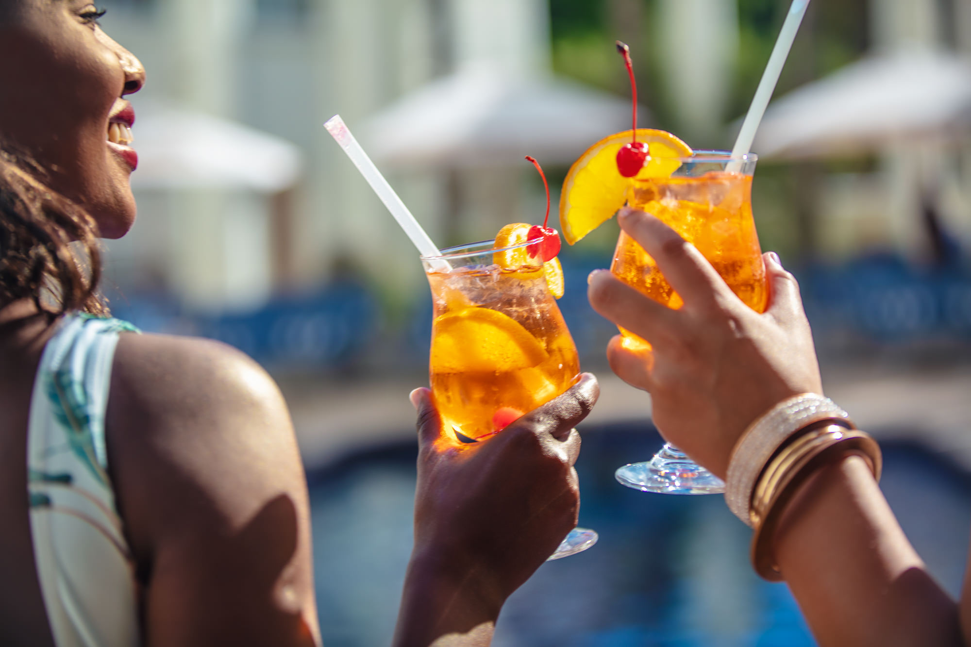 Image of girl friends having a drink at the Southern Sun The Cullinan Hotel at the pool for Tsogo Sun's Image Library & Content Library by Michelle Wastie Photography