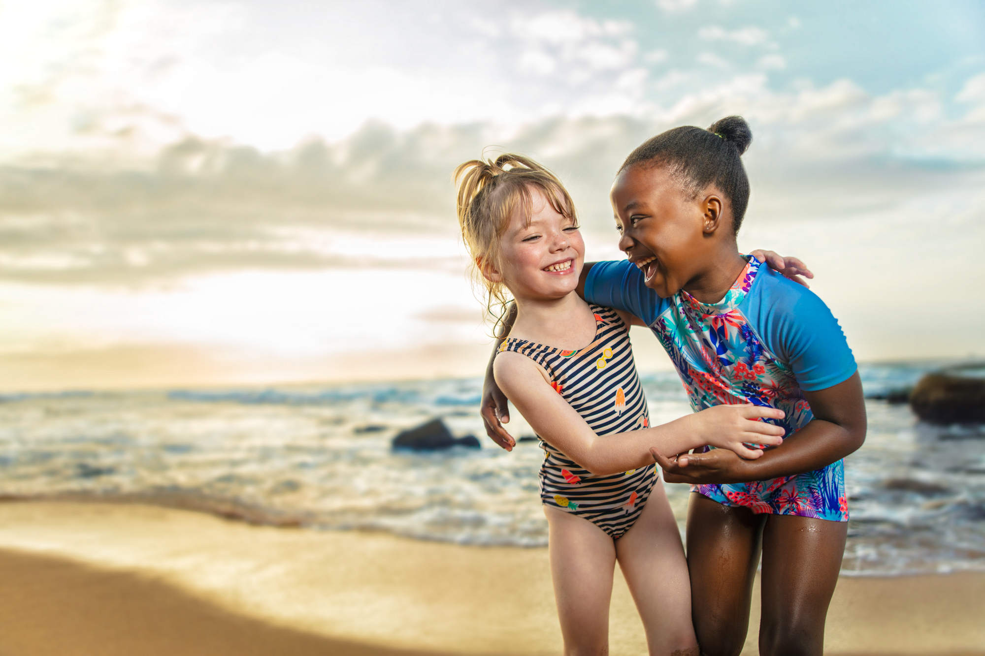 Image of girls playing on the beach at the Beverly Hills Hotel in uMhlanga Rocks, Durban for  Tsogo Sun's Image Library & Content Library by Michelle Wastie Photography